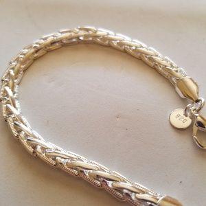 Jewelry - Sterling silver braided bracelet.